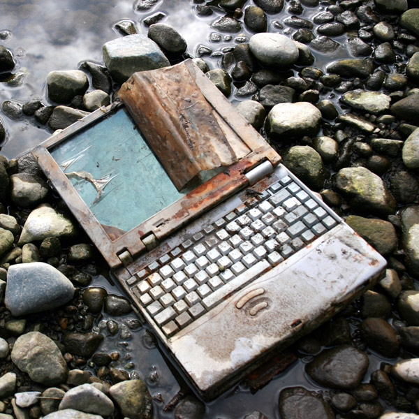 Old laptop and IT waste on the riverbed